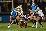 Junior Sau of Salford Red Devils is tackled high by Craig Huby during the Betfred Super League match at Belle Vue, Wakefield<br /> Picture by Richard Land/Focus Images Ltd +44 7713 507003<br /> 09/02/2018