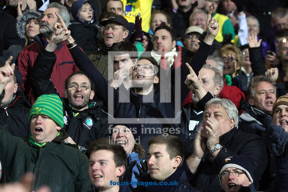 The traveling Norwich fans celebrate victory at the end of the match at the Goldsands Stadium, Bournemouth<br /> Picture by Paul Chesterton/Focus Images Ltd +44 7904 640267<br /> 10/01/2015