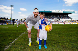 Match mascot with favourite player Matt Harrold (ENG) of Bristol Rovers - Photo mandatory by-line: Rogan Thomson/JMP - 07966 386802 - 03/05/2014 - SPORT - FOOTBALL - Memorial Stadium, Bristol - Bristol Rovers v Mansfield Town - Sky Bet League Two. (Note: Mansfield are wearing a Rovers spare kit having forgotten their own).