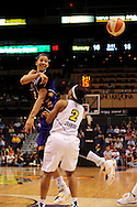 June 4, 2010; Phoenix, AZ, USA; Los Angeles Sparks foward Candace Parker makes a pass over defender Phoenix Mercury guard Temeka Johnson during the first half in at US Airways Center.  Mandatory Credit: Jennifer Stewart-US PRESSWIRE