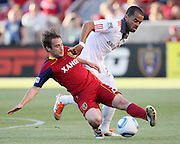 Real Salt Lake midfielder Ned Grabavoy, front, passes off the ball as Toronto FC forward Maicon Santos, back, defends during the first half of an MLS soccer game, Saturday, June 25, 2011, in Sandy, Utah. (AP Photo/Colin Braley)