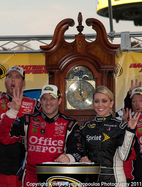 October 30, 2011; Martinsville, VA, USA; NASCAR Sprint Cup Series driver Tony Stewart (14) wins the TUMS Fast Relief 500 at Martinsville Speedway. Mandatory Credit: Kostas Lymperopoulos