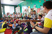 The children and C&A volunteers singing a song in the library.