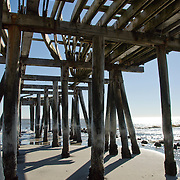 View in winter looking up under  broken pier in Atlantic City, NJ