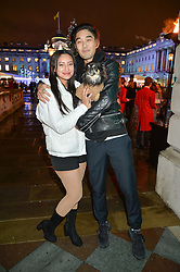 LEAH WELLER her dog Luna and TOMO KURATA at Skate At Somerset House with Fortnum & Mason on 16th November 2016.