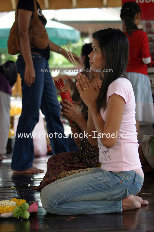 women Praying inside a Buddhist temple Thailand, Bangkok,