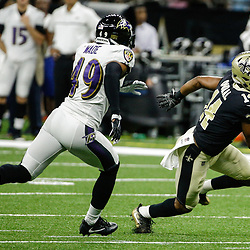 Aug 31, 2017; New Orleans, LA, USA; New Orleans Saints wide receiver Travin Dural (14) runs from Baltimore Ravens cornerback Trevin Wade (49) after a reception during the second quarter of a preseason game at the Mercedes-Benz Superdome. Mandatory Credit: Derick E. Hingle-USA TODAY Sports
