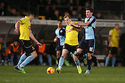 Damien McCrory goes past Peter Murphy during the Sky Bet League 2 match between Wycombe Wanderers and Burton Albion at Adams Park, High Wycombe, England on 17 November 2014.