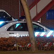 Beeindiging gijzeling Bovenmaatweg 271 Huizen, arrestant in politieauto