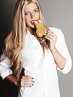 Blonde woman eating rabbit cookie