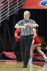 03 January 2014:  Referee Bob Trammel makes a traveling call during an NCAA women's basketball game between the Drake Bulldogs and the Illinois Sate Redbirds at Redbird Arena in Normal IL