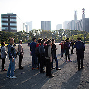 TOKYO, JAPAN - OCTOBER 19 : Chinese tourist infront Tokyo Imperial Palace on October 19, 2015 in Tokyo, Japan. <br /> <br /> Photo: Richard Atrero de Guzman