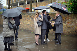 London Mayor Boris Johnson giving interviews while campaigning in the rain in Brixton during his Mayor Campaign, Wednesday April 25, 2012 Photo By Andrew Parsons /i-Images
