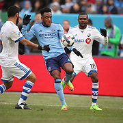 NEW YORK, NEW YORK - March 18: Rodney Wallace #23 of New York City FC challenged by Chris Duvall #18 of Montreal Impact and Victor Cabrera #36 of Montreal Impact during the New York City FC Vs Montreal Impact regular season MLS game at Yankee Stadium on March 18, 2017 in New York City. (Photo by Tim Clayton/Corbis via Getty Images)