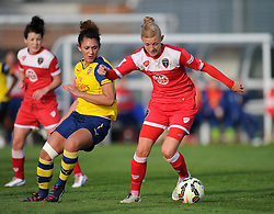 Bristol Academy's Nikki Watts battles for the ball with Arsenal Ladies' Jade Bailey - Photo mandatory by-line: Paul Knight/JMP - Mobile: 07966 386802 - 09/05/2015 - SPORT - Football - Bristol - Stoke Gifford Stadium - Bristol Academy Women v Arsenal Ladies FC - FA Women's Super League