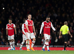 LONDON, ENGLAND - Thursday, December 5, 2019: Arsenal's Granit Xhaka (L) and Alexandre Lacazette look dejected as Brighton & Hove Albion score the opening goal during the FA Premier League match between Arsenal FC and Brighton & Hove Albion FC at the Emirates Stadium. (Pic by Vegard Grott/Propaganda)