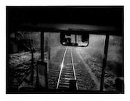 Driving train into a blinding Chichibu sun, Saitama Province, Japan.