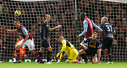 LONDON, ENGLAND - Sunday, December 9, 2012: Liverpool's captain Steven Gerrard looks dejected after scoring an own goal to hand West Ham United their second goal during the Premiership match at Upton Park. (Pic by David Rawcliffe/Propaganda)
