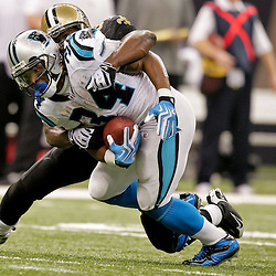 Nov 08, 2009; New Orleans, LA, USA;  New Orleans Saints linebacker Jonathan Vilma (51) tackles Carolina Panthers running back DeAngelo Williams (34) during the fourth quarter at the Louisiana Superdome. The Saints defeated the Panthers 30-20. Mandatory Credit: Derick E. Hingle