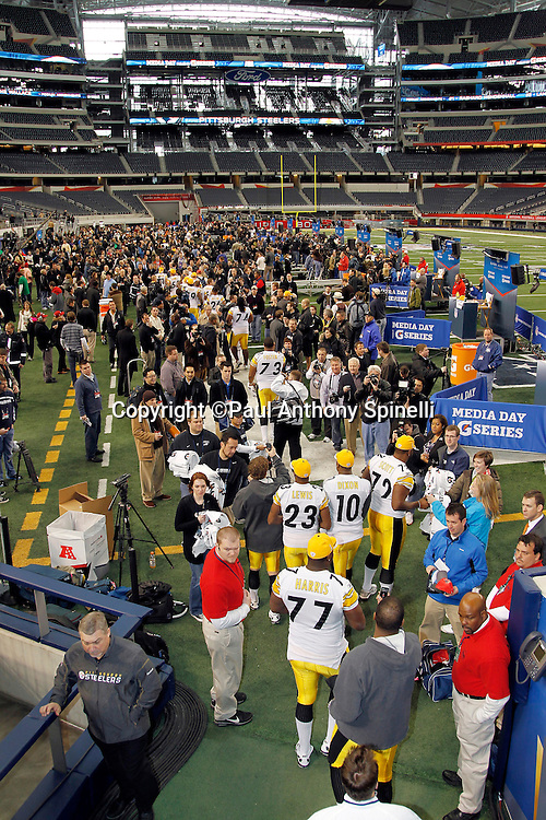 Members of the AFC Pittsburgh Steelers come out of the tunnel to speak to the press in this general view of the interior of Cowboys Stadium at Super Bowl XLV media day prior to NFL Super Bowl XLV against the Green Bay Packers. Media day was held on Tuesday, February 1, 2011 in Arlington, Texas. ©Paul Anthony Spinelli