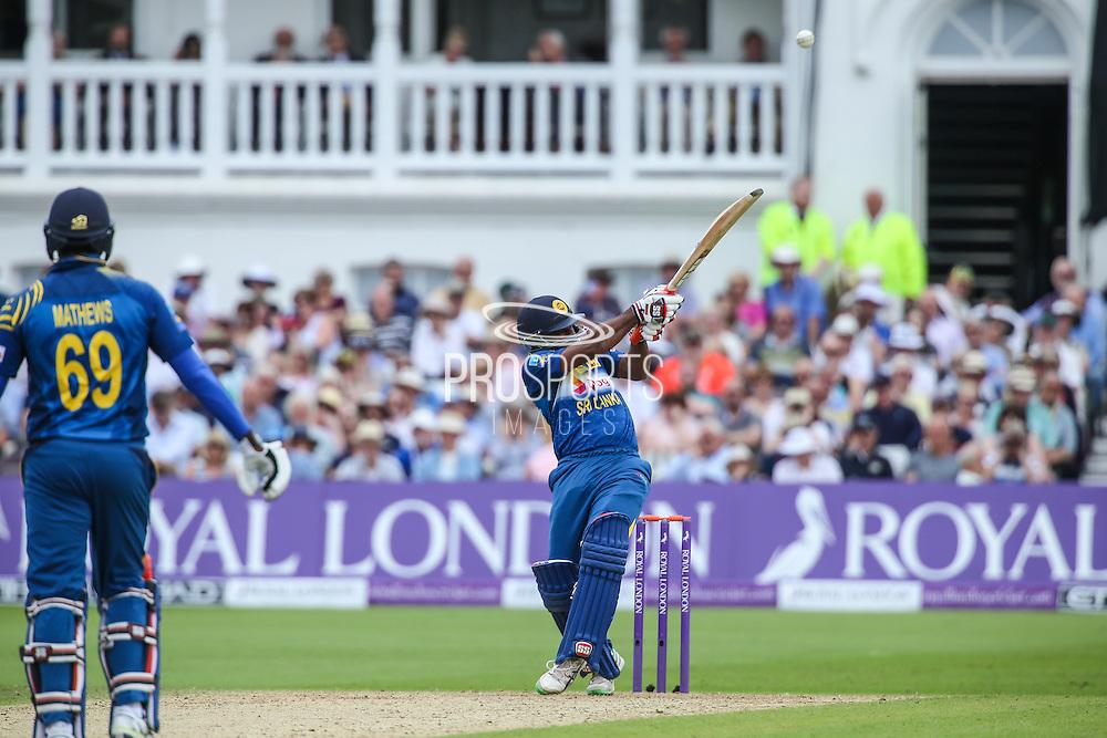 Sri Lanka's Seekkuge Prasanna hits a six  during the Royal London ODI match between England and Sri Lanka at Trent Bridge, West Bridgford, United Kingdon on 21 June 2016. Photo by Shane Healey.