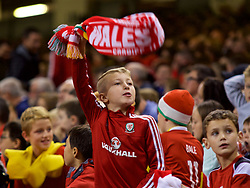 CARDIFF, WALES - Thursday, October 11, 2018: A young Wales supporter with a vuvuzela during the International Friendly match between Wales and Spain at the Principality Stadium. (Pic by Lewis Mitchell/Propaganda)
