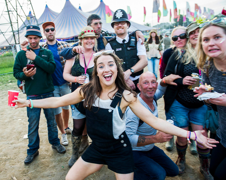 The police get into festival spirit. The 2015 Glastonbury Festival, Worthy Farm, Glastonbury.