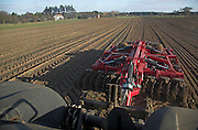 Sumo Quatro Multipaka cultivator drawn by tractor cultivating field Rendlesham Suffolk England
