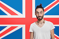 Portrait of young Asian man in white t-shirt against British flag