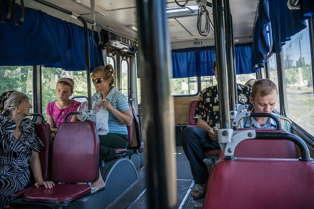 MARIUPOL, UKRAINE - AUGUST 31, 2015: Passengers aboard a trolley bus in Mariupol, Ukraine. This eastern district of Mariupol, closer than downtown to the front lines, was hit by heavy shelling in January that killed approximately 30 people. CREDIT: Brendan Hoffman for The New York Times