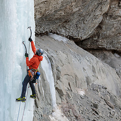 Greg Sievers climbing an unnamed ice route beside High on Boulder in Cody Wyoming