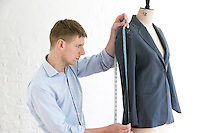 Tailor measuring jacket sleeve side view