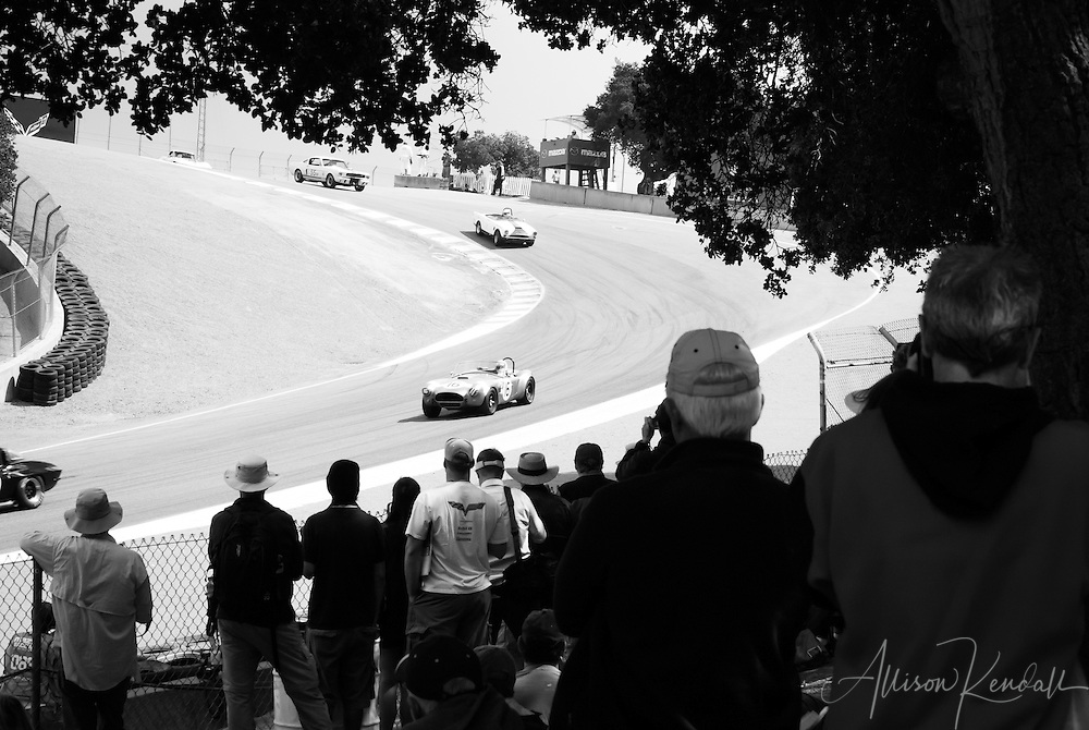 Event spectators watch the racing action in the corkscrew of Laguna Seca at the Rolex Monterey Motorsports Reunion during Monterey Car Week