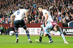 Aston Villa's Joe Bennett falls through the Spur's defence of Tottenham Hotspur's Vlad Chiriches and Erik Lamela  - Photo mandatory by-line: Nigel Pitts-Drake/JMP - Tel: Mobile: 07966 386802 24/09/2013 - SPORT - FOOTBALL -  Villa Park - Birmingham - Aston Villa v Tottenham Hotspur - Round 3 - Capital One Cup