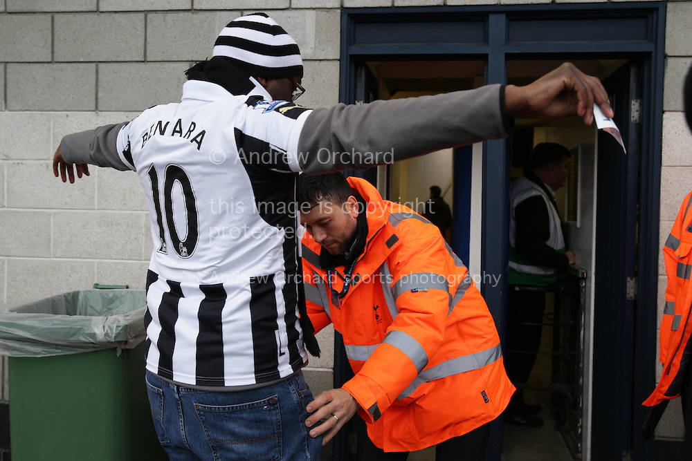 a Newcastle United fan is searched by security before he enters White Hart Lane Stadium before k/o. Barclays Premier league match, Tottenham Hotspur v Newcastle Utd at White Hart Lane in London on Sunday 13th December 2015.<br /> pic by John Patrick Fletcher, Andrew Orchard sports photography.