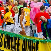 NLD/Amsterdam/20100807 - Boten tijdens de Canal Parade 2010 door de Amsterdamse grachten. De jaarlijkse boottocht sluit traditiegetrouw de Gay Pride af. Thema van de botenparade was dit jaar Celebrate, Susan Blokhuis