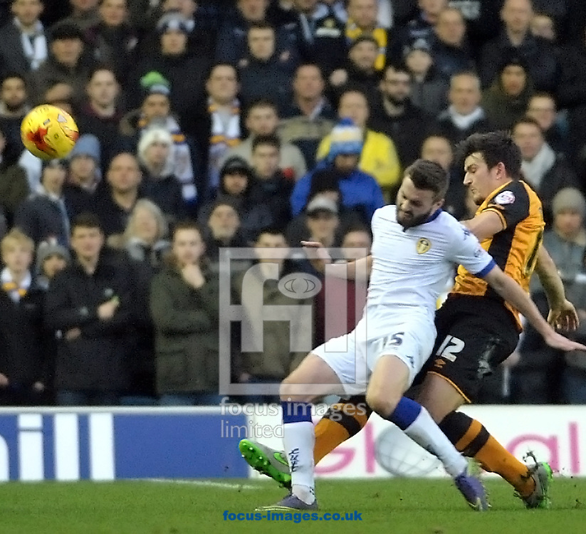Stuart Dallas of Leeds United feels the challange from Harry Maguire of Hull City during the Sky Bet Championship match at Elland Road, Leeds<br /> Picture by Graham Crowther/Focus Images Ltd +44 7763 140036<br /> 05/12/2015