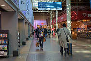 Washington, DC, USA --  March 16, 2019. Commuters walk briskly along past the shops in Union Station  in Washington D.C.
