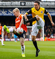 Mark Cullen of Luton Town and Gregor Robertson of Northampton Town battle for the ball during the Sky Bet League 2 match at Kenilworth Road, Luton<br /> Picture by David Horn/Focus Images Ltd +44 7545 970036<br /> 25/10/2014