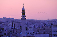 Minerettes over the cityscape of Amman at sunset..Amman, Jordan. 29/11/2011.Photo © J.B. Russell