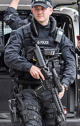 © Licensed to London News Pictures. 16/09/2017. London, UK. Heavily armed police officers on patrol around the Houses of Parliament in London, the day after a bomb partly exploded on a tube train at Parsons Green station in London injuring members of the public. Operation temperer has been put in to place after the UK terror threat level was raised to critical. Photo credit: Ben Cawthra/LNP