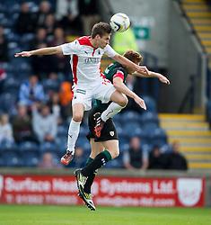 Falkirk's Luke Leahy over Raith Rovers Jason Thomson.<br /> half time : Raith Rovers 0 v 0 Falkirk, Scottish Championship game played 27/9/2014 at Raith Rovers Stark Park.