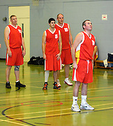 UK - Tuesday, Nov 18 2008:  Jonny Lee (#12), Mark Denchfield (#5), Dave Churches (#15) watch Declan McCusker's (#10) free throw attempt towards the end of Barking and Dagenham Erkenwald Basketball Club's Essex Basketball League game against Brightlingsea Sledgehammers. (Photo by Peter Horrell / http://www.peterhorrell.com)