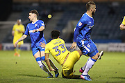 AFC Wimbledon striker Lyle Taylor (33) tumbles between Gillingham FC midfielder Max Ehmer (5) and Gillingham FC midfielder Mark Byrne (33) during the EFL Sky Bet League 1 match between Gillingham and AFC Wimbledon at the MEMS Priestfield Stadium, Gillingham, England on 21 February 2017. Photo by Stuart Butcher.