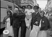 Maureen Potter with The Dublin Fire Brigade..1986..19.07.1986..07.19.1986..19th July 1986..Dublin Fire Brigade aided and abetted by Maureen Potter staged a collection,today,in aid of The Royal Victoria Eye and Ear Hospital,Adelaide Road,Dublin. It is hoped that the proceeds would go towards the purchase of a laser eye scanner. The Eye and Ear Hospital was established in 1897 and has served not only Dublin but the whole country as well...Small in stature but big in personality, picture shows Maureen encouraging donations from the public. She is well supported by Dublin Fire brigade and the nurses from the Eye And Ear Hospital.