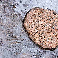 Granite pebble frozen in the Saco River New Hampshire USA
