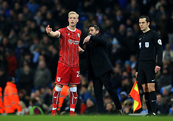 Hordur Magnusson of Bristol City talks with Bristol City head coach Lee Johnson  - Mandatory by-line: Matt McNulty/JMP - 09/01/2018 - FOOTBALL - Etihad Stadium - Manchester, England - Manchester City v Bristol City - Carabao Cup Semi-Final First Leg