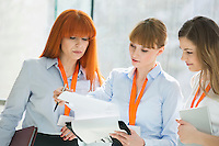 Businesswomen doing paperwork in office