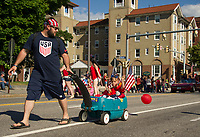 Laconia's 4th of July parade heads up North Main Street towards Opechee Park Tuesday afternoon.  (Karen Bobotas/for the Laconia Daily Sun)