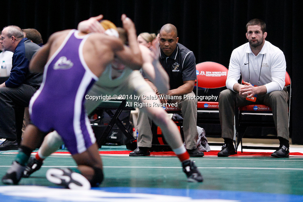 NCAA Division III Wrestling National Championships<br /> Session II<br /> <br /> CEDAR RAPIDS, Iowa (Feb. 14, 2014) -- Ferrum Head Coach Nate Yetzer (right) and Asst. Coach Brandon Bradley watch action between Ferrum's Logan Meister and Mount Union's Bryant Roby at the 2014 NCAA Div. III Wrestling National Championships. Meister won the match 6-1 in sudden victory 1.